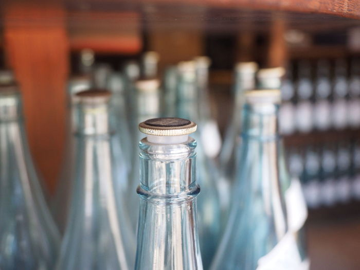 Close-Up Of Bottles In Bar