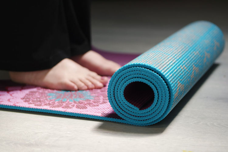 Close-Up Of Woman On Exercise Mat