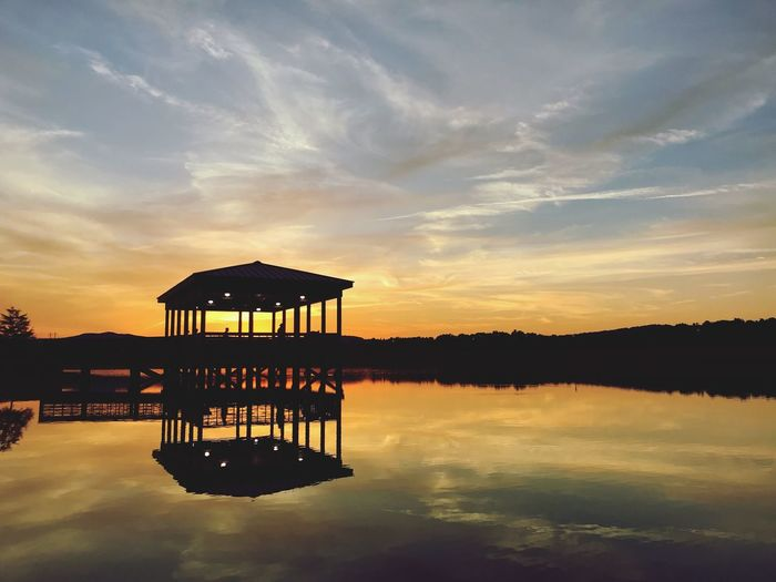 Water Sky Sunset Reflection Cloud - Sky Lake Beauty In Nature Tranquility Waterfront Scenics - Nature Nature Tranquil Scene Architecture Built Structure Gazebo Silhouette No People Pier Orange Color