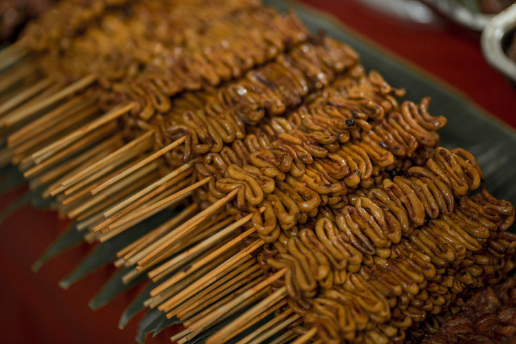 "We call it ""Isaw"" Food And Drink Food Indoors  Close-up No People Focus On Foreground Abundance Large Group Of Objects Selective Focus In A Row Still Life Snack Retail  Order Ready-to-eat High Angle View Freshness Skewer Arrangement Pattern"
