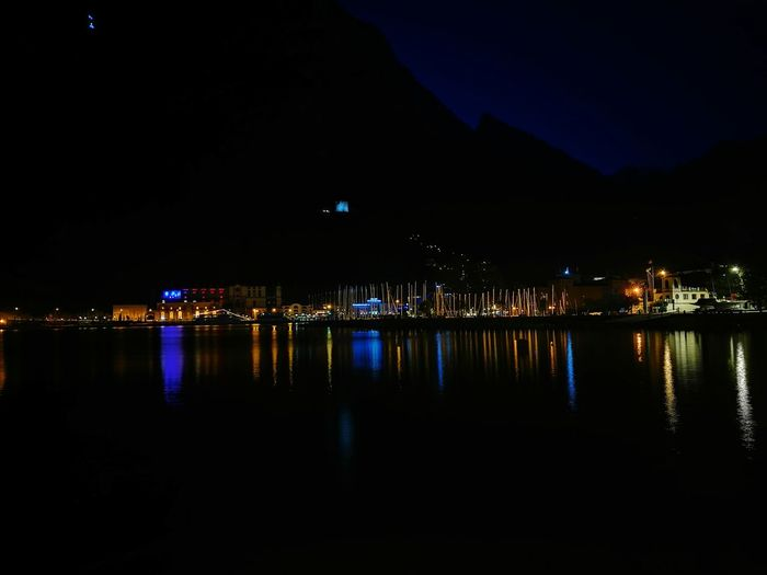 Scenic view of river against sky at night