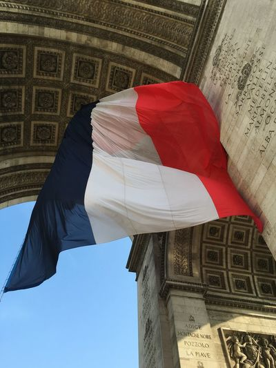 Low Angle View Of French Flag At Historic Building
