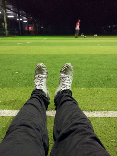 Sports time Grass Low Section Sport Leisure Activity Adults Only Lifestyles Night Green Color One Person Match - Sport Human Leg Real People Only Men People Outdoors Adult Sportsman One Man Only Human Body Part
