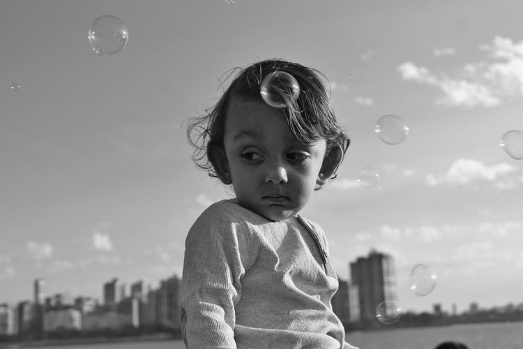 Portrait of baby boy with bubbles