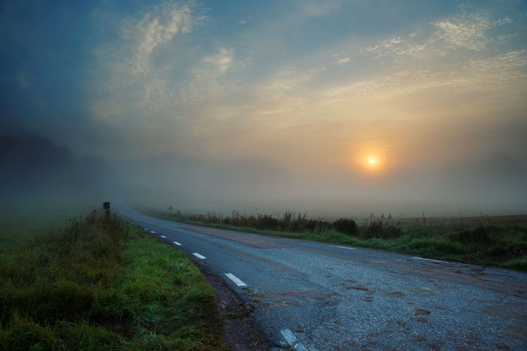 Early morning Beauty In Nature Cloud - Sky Cloudy Country Road Empty Road Field Landscape Nature Road Scenics Sky Sun Sunrise The Way Forward Tranquil Scene Tranquility Weather