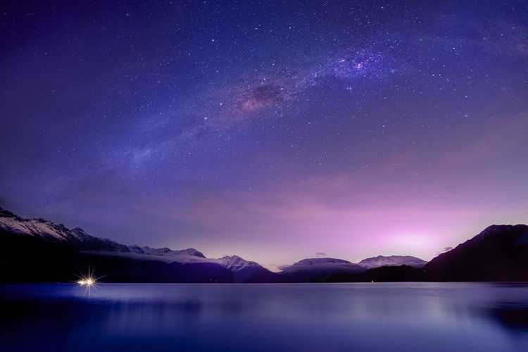 Scenic View Of Lake Against Mountain At Night