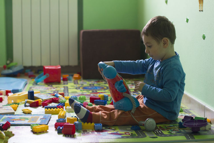 Childhood Day Home Interior Indoors  Leisure Games Multi Colored One Person People Playing Real People Side View Sitting Toy Home Home Showcase Interior