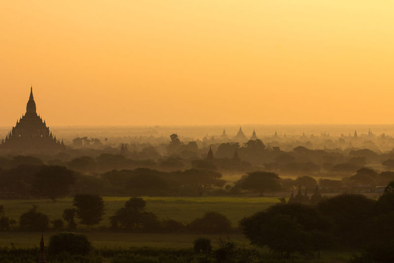 Nice sunrise view of Bagan in Burma Bagan Bagan, Myanmar Burma Sky Fog Architecture Built Structure Building Exterior Travel Destinations Sunset Scenics - Nature No People Nature Environment Landscape Tree Place Of Worship Religion Plant Belief Beauty In Nature Outdoors Ancient Civilization