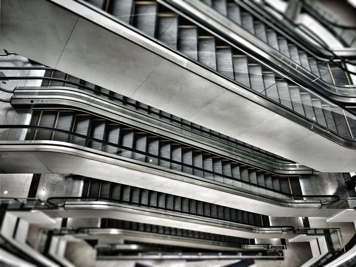 Escalators at a mall Architecture Built Structure Day Indoors  No People Escalator Chrome