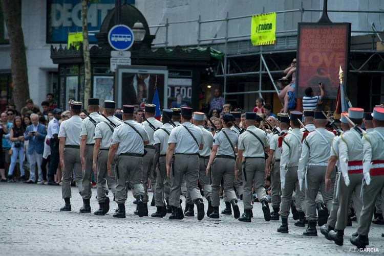 Rear View Of Military Parade On Street