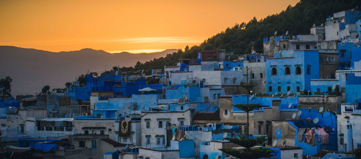 Village sunset Africa Architecture Blue Building Chefchaouen City Clouds Culture Light And Shadow Morocco Mountain Outdoors Sky Sun Sunset Tourismalberta Town Travel Villa