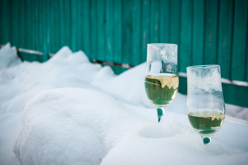 Champagne in glass on snow