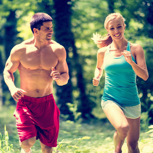 Couple Running At Park