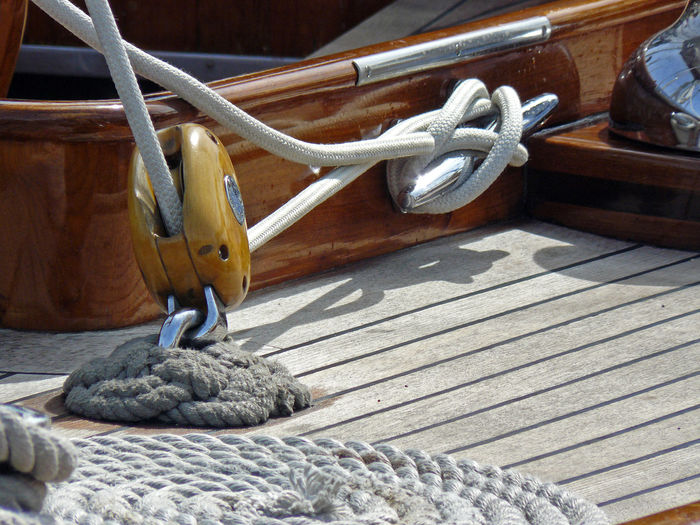 Close-up of ropes tied to pulley in boat