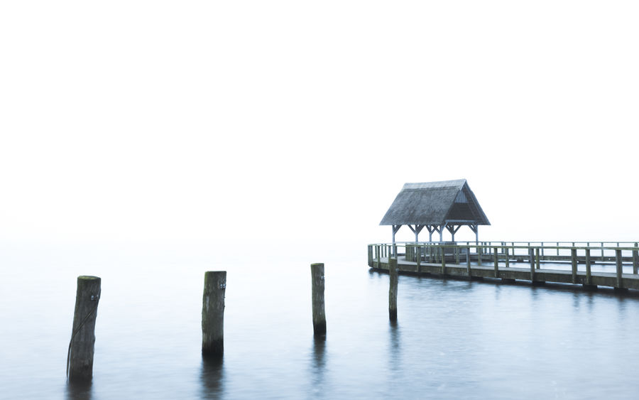 Into white Architecture Beauty In Nature Built Structure EyeEm Best Edits Fog Foggy Morning Fresh On Eyeem  FUJIFILM X-T2 Hemmelsdorfer See Idyllic Jetty Lake Lake View Landscape Miles Away Nature No Photoshop Outdoors Schleswig-Holstein See The White Collection Tranquility Water White Wood Art Is Everywhere The Great Outdoors - 2017 EyeEm Awards Been There. Shades Of Winter