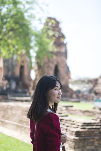 Young woman standing in temple