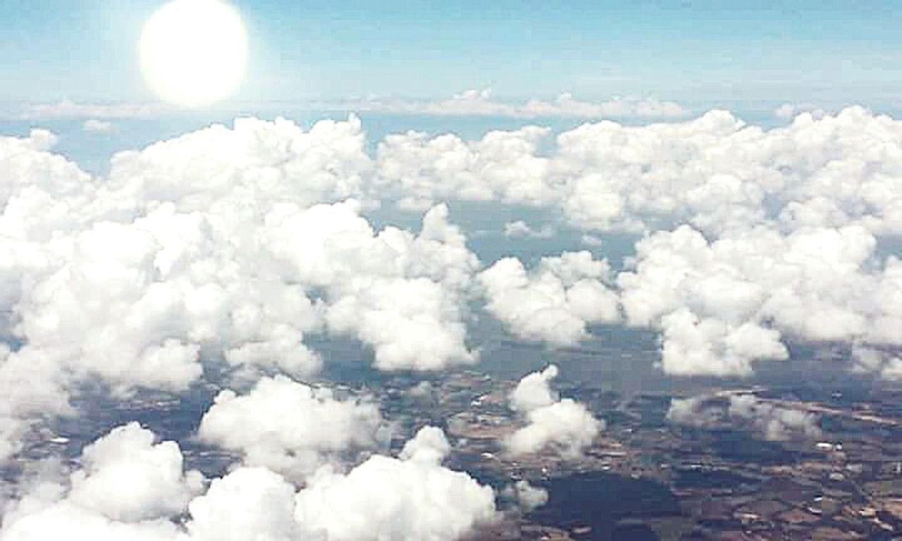 cloud - sky, aerial view, cloudscape, sky, white color, flying, scenics, nature, outdoors, sunlight, no people, mid-air, blue, summer, airplane, day, beauty in nature, cityscape, space