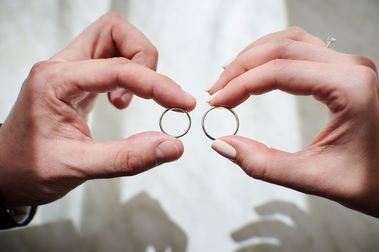 Cropped image of hands holding rings