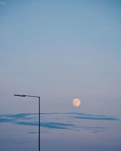 10 Iseenumbers Minimal Minimalism Sky Moon Scenics - Nature Beauty In Nature Blue No People 10 Tranquility Full Moon Cloud - Sky Dusk Tranquil Scene Outdoors The Traveler - 2018 EyeEm Awards HUAWEI Photo Award: After Dark A New Beginning
