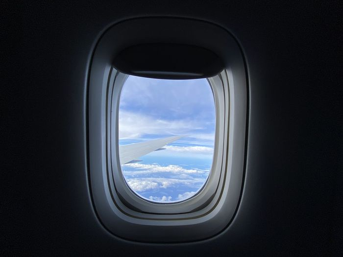 Cloudy sky seen through airplane window