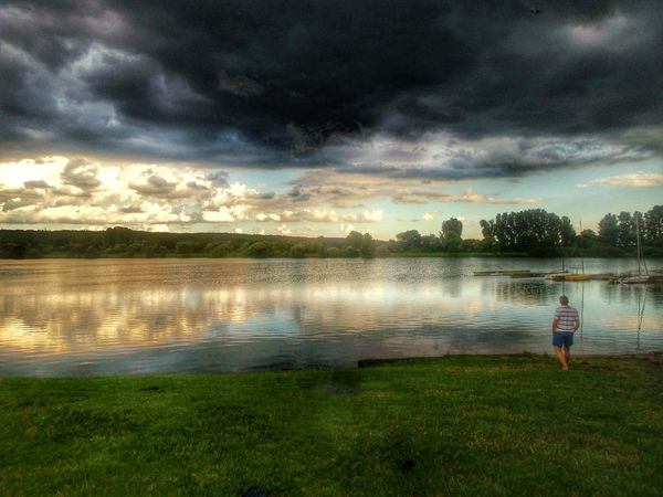 same lake, same evening, another direction Lonely Man Watching The Sky Reflections In The Water Calm Before The Storm Reflections And Shadows A Storm Is A Brewing Before Sunset Clouds And Sky Dramatic Sky Lakeside Sun Behind Clouds Hidden Gems  Showcase July Langenselbold Germany🇩🇪