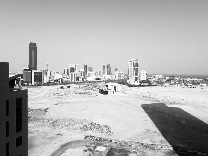 Urban Skyline City Outdoors Cityscape Day Building Exterior Sky No People Skyscraper Architecture Nature Minimalist Architecture Sand Black & White Bnw_collection Blackandwhite Bnwcity Bwoftheday Manama Bahrain Bahrainlife Bnw_city Bahrain Black&white BW_photography Shadows_collection