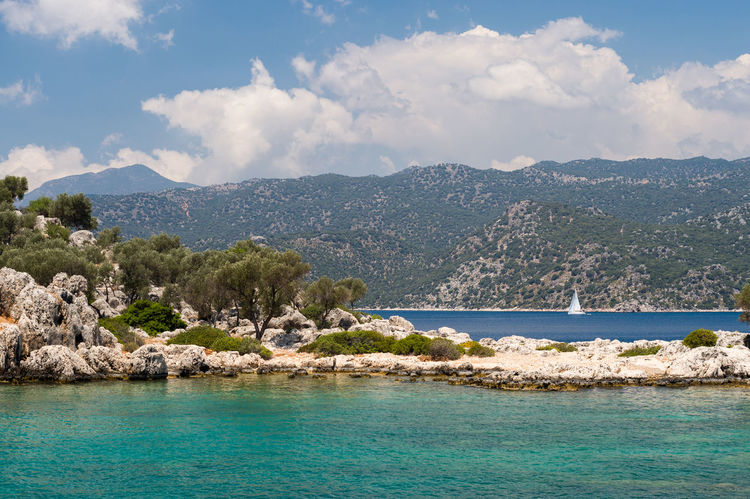 Kekova Seascape Beauty In Nature Blue Calm Clouds And Sky Demre Fine Art Photography Idyllic Kekova Landscape Landscape_Collection Landscape_photography Mountain Range Natanomalous.com Nature Nature Photography Nature_collection Outdoors Remote Scenics Sea Sea And Sky Seascape Tranquil Scene Tranquility Turquoise