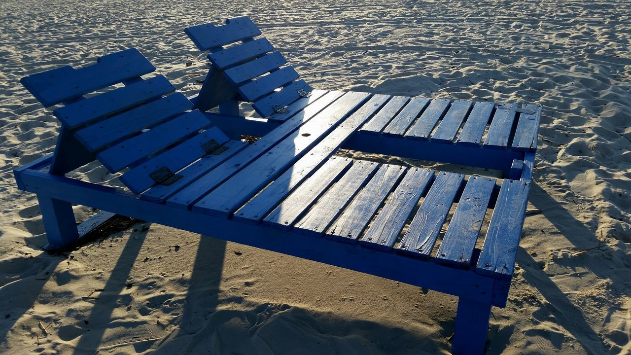 bench, absence, empty, shadow, sunlight, sand, high angle view, wood - material, day, outdoors, relaxation, seat, no people, beach, nature