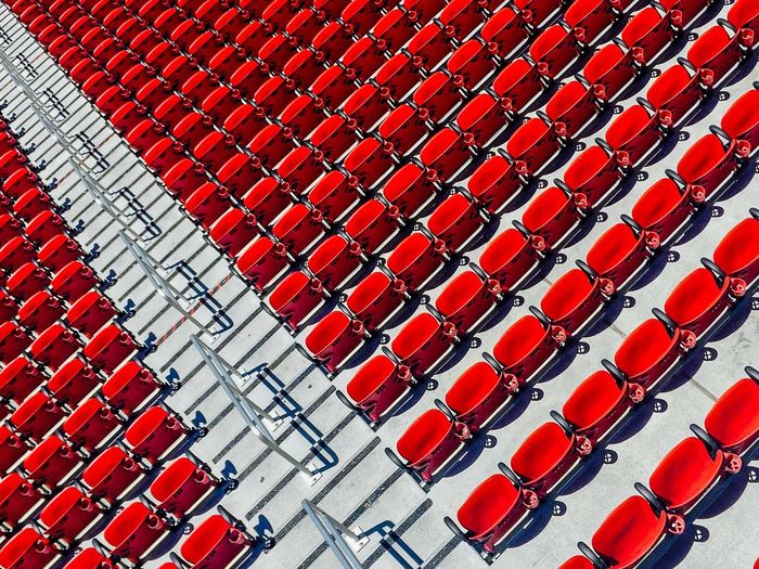 High angle view of red seats at stadium