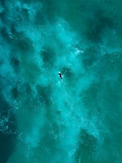 Aerial view of person surfing in sea