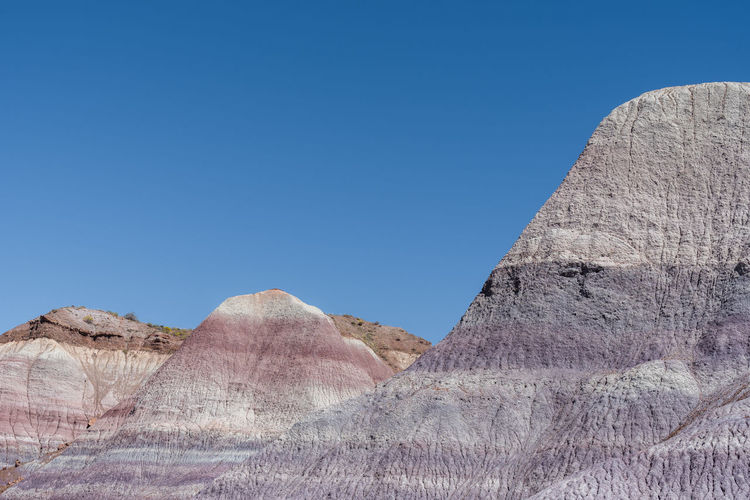 Landscape of barren purple badlands at blue mesa in petrified forest national park in arizona