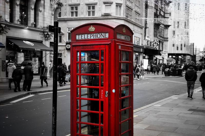 Telephone Building Exterior Communication Architecture Telephone Booth Built Structure Red Street Text City Pay Phone