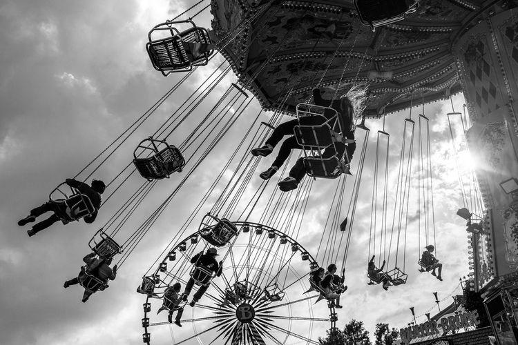 Düsseldorf, Germany Arts Culture And Entertainment Backlight Backlit Blackandwhite Chairoplane Cloudy Düsseldorf Funfair Karussell Kettenkarussell Rheinkirmes Schwarzweiß Swing Carousel Monochrome Photography