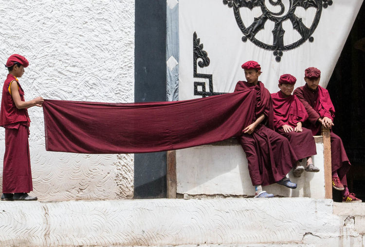Child Buddhist Monks at Hemis Monastery in Ladakh in India. Buddhist Monastery Buddhist Monk Buddhist Monk's Robe India Tibetan Buddhism Adult Architecture Buddhism Buddhist Monks Building Exterior Day Ladakh Lovers Men Outdoors People Real People Red Sitting Tibetan Culture Togetherness Traditional Clothing