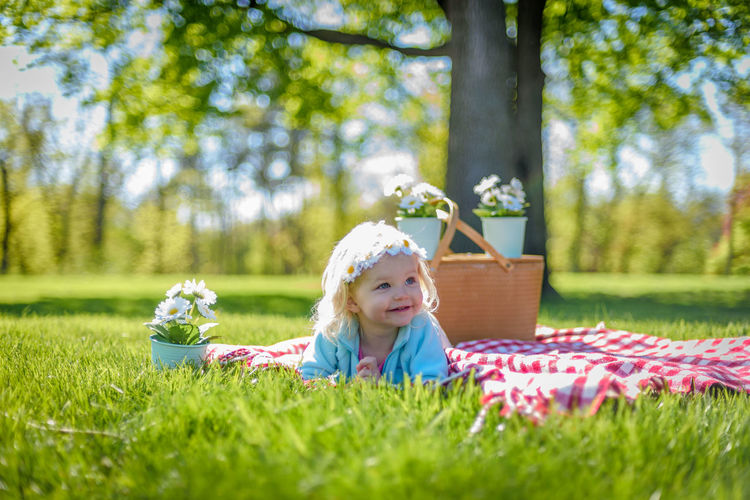 Little blonde girl laying on blanket in park with picnic basket and daisies on sunny spring day Spring Sunny Day Outdoors Selective Focus Spring Flowers Spring 2017 Picnic Basket Picnic Daisies Child One Child Happy Happy People Smiling Face Smiling Girl Little Girl Park Life Outdoor Photography Kids Photography Kidsphotography Laying In The Grass Female Toddler  Headband Caucasian