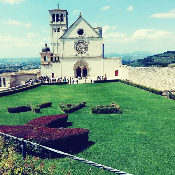 Assisi Grass Sky Architecture Shadow No People Place Of Worship Religion Building Exterior Built Structure Outdoors City Landscape Day Clock Tower