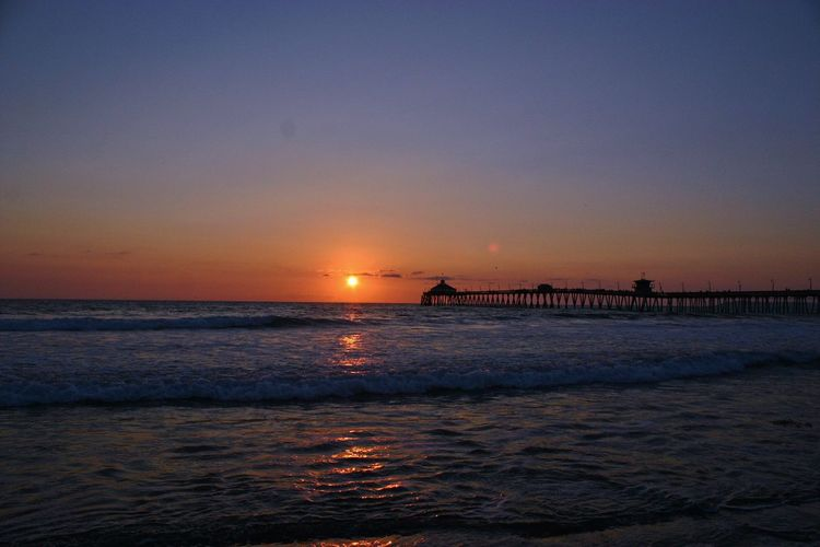 Sunset Sea Water Beauty In Nature Nature Scenics Sky Tranquility Built Structure Waterfront Tranquil Scene No People Sun Horizon Over Water Architecture Outdoors Wave Silhouette Beach Clear Sky