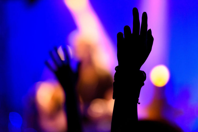 Live Concert Concert Dark Focus On Foreground Glowing Hands Lens Flare Multi Colored Outdoors Selective Focus
