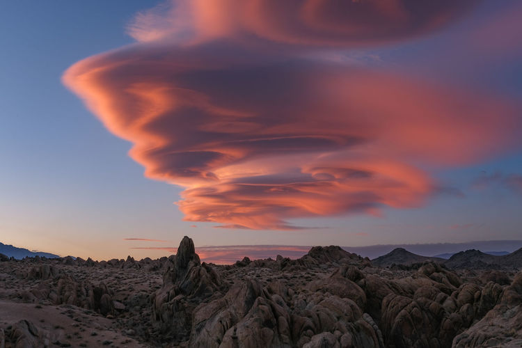 Looking up at the sky at sunset with a vibrant lenticular cloud overhead