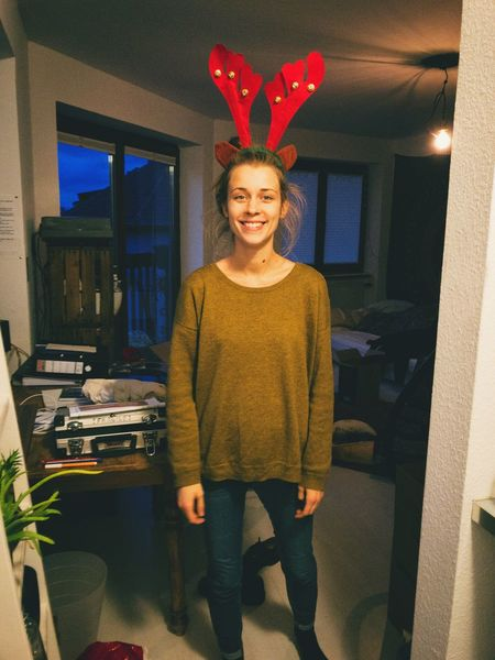 Looking At Camera Smiling Indoors  Portrait Happiness One Person Lifestyles Young Adult Real People Standing Young Women Cheerful Day People Christmas Time FUNNY ANIMALS Moose Christmas Decorations Christmas Fun Mask - Disguise