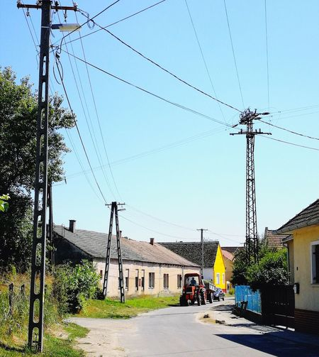Paint The Town Yellow Village Life Tractors Cable Power Line  Day Outdoors Yellow House  Mohács Mobility In Mega Cities