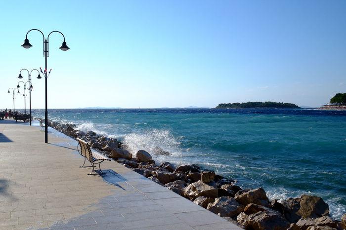 Primosten, Croatia Primošten Beach Beauty In Nature Blue Clear Sky Day Horizon Over Water Nature No People Outdoors Scenics Sea Sky Street Light Water Wave