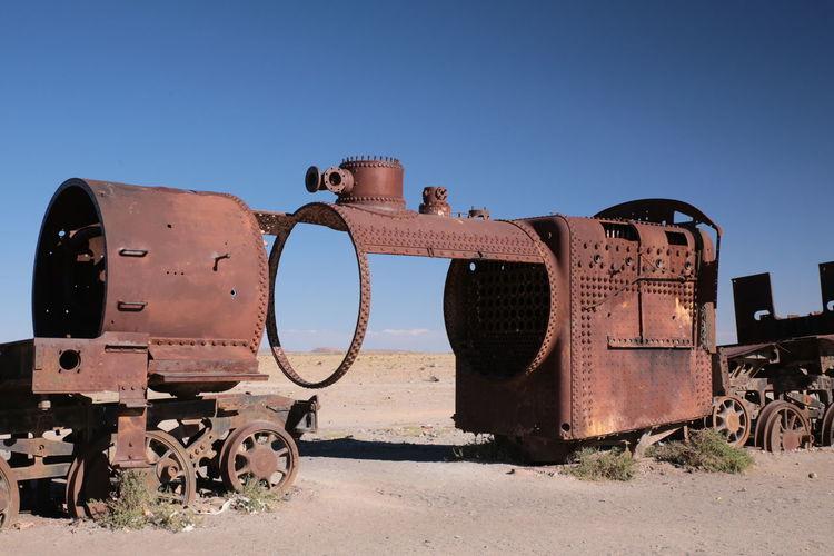 Abandoned Train At Desert Against Blue Sky