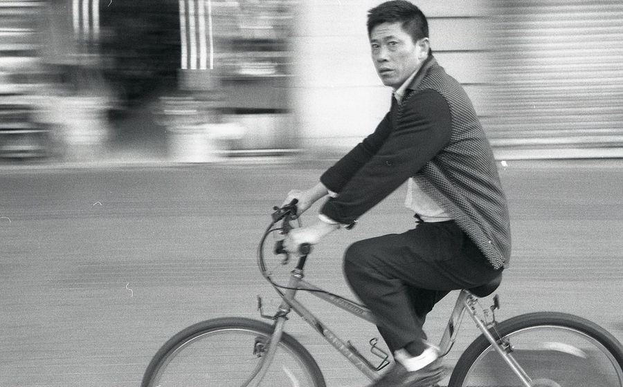 Bicycle Bike Black And White Blackandwhite Casual Clothing City City Cycling Land Vehicle Looking At Camera Mode Of Transport Person Street Photography Streetphotography Transportation Urban