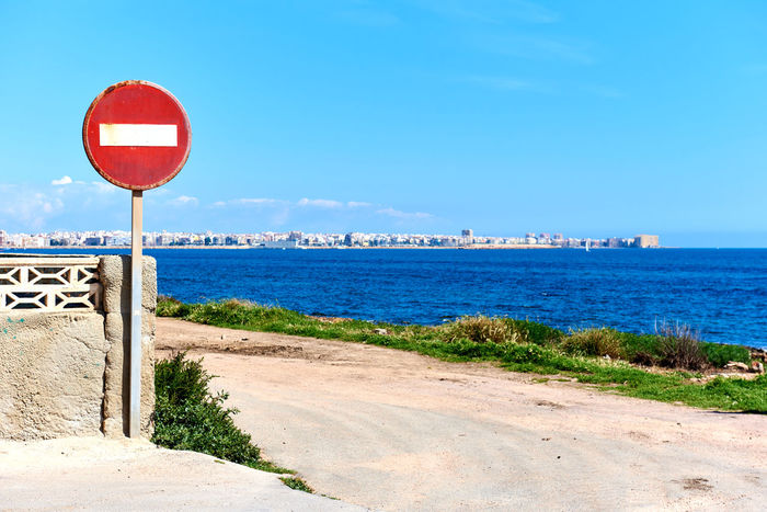 No Entry road sign, on the coast of Torrevieja. Costa Blanca. Spain Alicante Province Spain Area Caution Caution Sign Costa Blanca Do Not Enter Entrance Mediterranean Sea No Entry SPAIN Sign Torrevieja Torrevieja, Spain Day Do Not Enter Sign Nature No Entry Sign No Vehicles Outdoors Prohibition Restriction Road Sign Sea Stop Sign Symbol