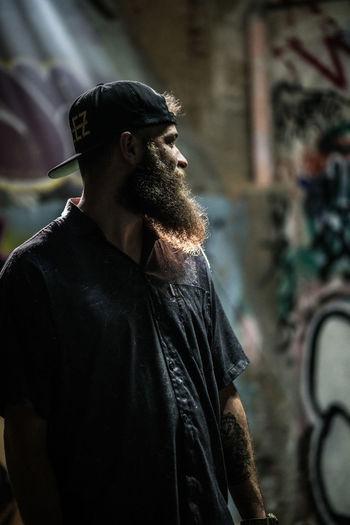 Bearded man looking away
