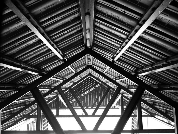 proof is not in the pudding, but proof is in the roof. #pentagon #parallels #blacknwhite #beachcottage #cottage #photography #travelphotography Asian Culture #symetry #converge #pentagon #parallels #blacknwhite #beachcottage #cottage #photography #travelphotography #lines #angle #geometry #rafters #beams #shelter Girder Backgrounds Full Frame Roof Pattern Architecture Built Structure