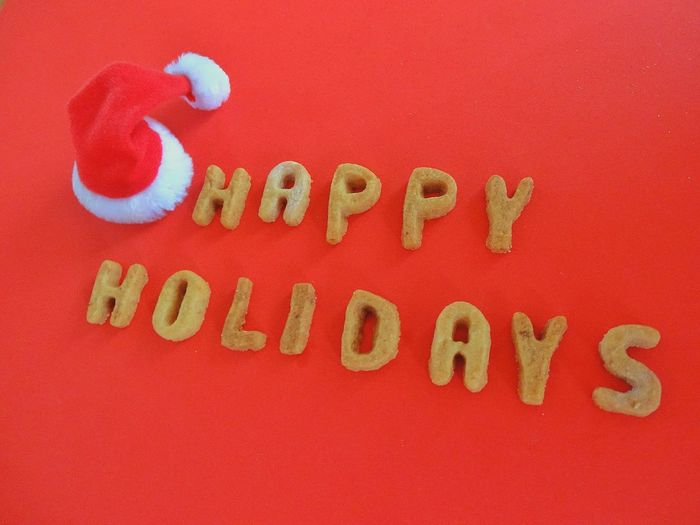 Text Happy Holidays Santas Hat Hat Red Hat Western Script Red Food Food And Drink Indoors  Alphabet Studio Shot No People Letters Cookies Words Christmastime Christmas Decoration Homemade