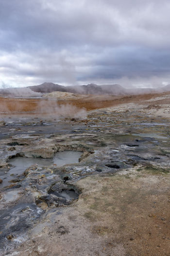 Hverir, pods, stinky steam, and hills A nice view from a vantage point over. Boiling pods, hills, very romantic. Hot Hverarönd Mars Myvatn Steam Boiling Empty Geothermal  Grey Hverir Mud Orange Color Otherworldly Puddle Road Trip Rotten Egg Stink Sulfur