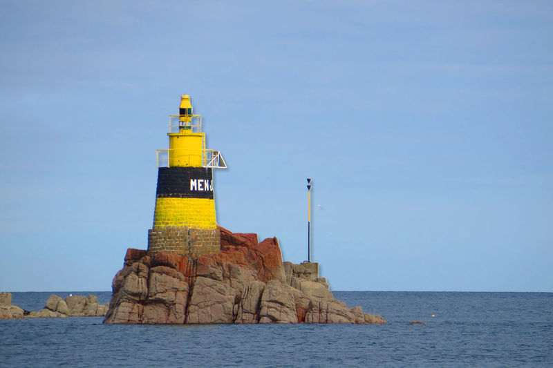 Balise au large de Bréhat Architecture Bretagne Brittany Bréhat Clear Sky Guidance Horizon Over Water Iledelareunion Jaune Lighthouse Mer Paysage Phare Photodujour Photooftheday Picoftheday Rocher Sea Sky Tourism Tourism Destination Tower Water Yellow île